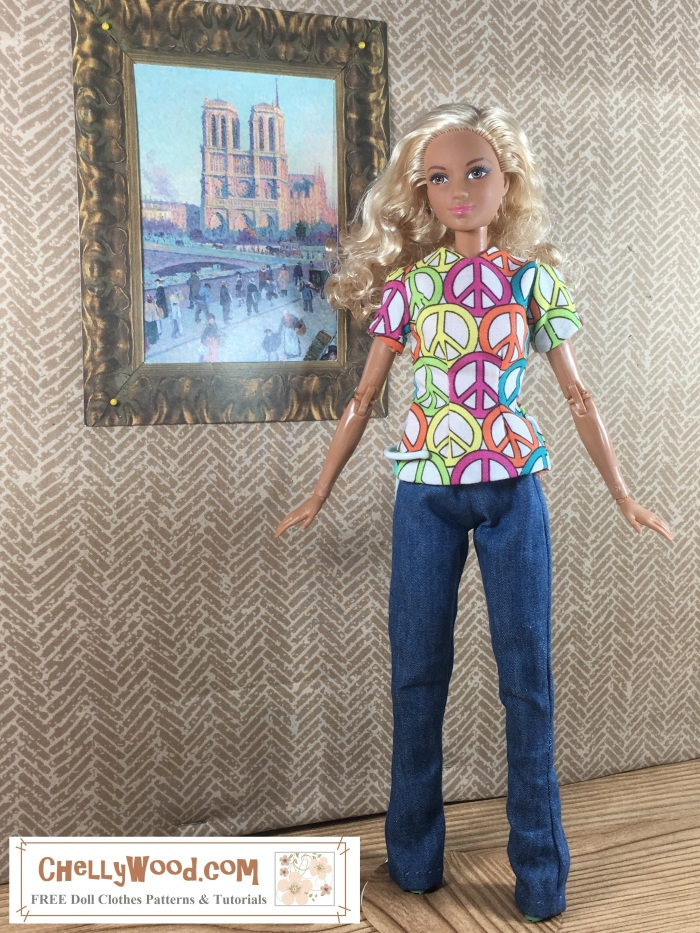 """Image shows Mattel's Made-to-Move Barbie wearing a handmade shirt decorated with peace signs and a handmade pair of elastic-waist pants (jeans). She stands with arms and legs spread wide to show that the jeans' hem touches the wood-look floor upon which she stands. The painting on the wall behind her is a 1:6 scale copy of Monet's painting of Notre Dame Cathedral in Paris, France. The Barbie looks to her left, and her blond curls flutter around one shoulder. Her skin is very tan, almost as if she may be of African American or another olive-complected or brown-complected ethnic heritage. Her lovely features seem to say, """"I'm showing off my new hand-made clothes!"""""""