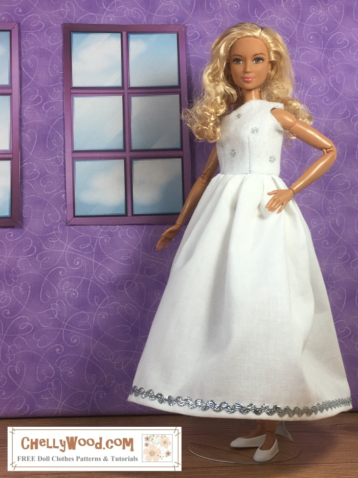 """Image shows a made-to-move Barbie from Mattel wearing a handmade wedding gown. The bodice of the gown, which is made of felt, covers one of the doll's shoulders, leaving the other exposed. The bodice is spotted with silver polka dots. The skirt is pure white and gathered, with a silvery rick-rack decorating the bottom of the skirting. Her tiny white flat shoes peek out from under the long wedding gown. She stands before a purple wall that has two simple windows looking out at a cloudy sky. The doll's hair is blond with curls, and the overlay says, """"ChellyWood.com: FREE printable sewing patterns and more."""""""