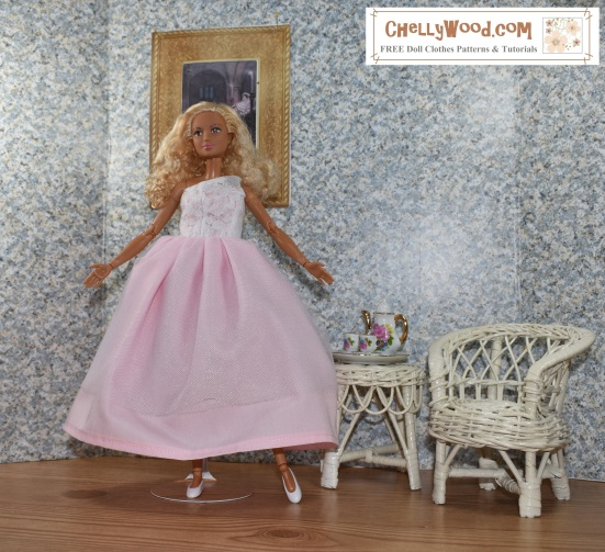 "Image shows a Made-to-Move Barbie wearing a hand-made quinceañera style ball gown with a lacy one-shoulder bodice. The doll stands in a 1:6 scale room complete with a painting on the wall, a wicker table, and a wicker chair. The wall paper has a speckled look to it. The floor of the doll's diorama looks like hard wood. Atop the wicker table is a porcelain tea set in 1:6 scale, with Barbie-pink flowers decorating it. The handles of the cups and teapot look like they are golden. The made-to-move Barbie poses with one leg extended and her toes pointed like a ballerina. Her arms are open wide, welcoming the viewer into her Barbie doll house. The overlay says, ""ChellyWood.com"" and below that, it says, ""FREE printable sewing patterns for dolls of many shapes and sizes."""