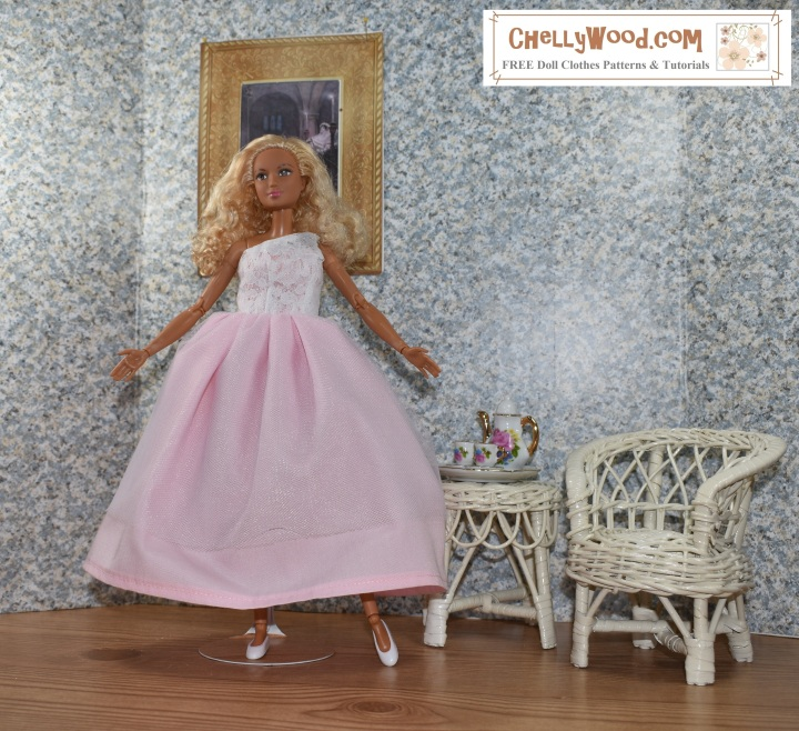 """Image shows a Made-to-Move Barbie wearing a hand-made quinceañera style ball gown with a lacy one-shoulder bodice. The doll stands in a 1:6 scale room complete with a painting on the wall, a wicker table, and a wicker chair. The wall paper has a speckled look to it. The floor of the doll's diorama looks like hard wood. Atop the wicker table is a porcelain tea set in 1:6 scale, with Barbie-pink flowers decorating it. The handles of the cups and teapot look like they are golden. The made-to-move Barbie poses with one leg extended and her toes pointed like a ballerina. Her arms are open wide, welcoming the viewer into her Barbie doll house. The overlay says, """"ChellyWood.com"""" and below that, it says, """"FREE printable sewing patterns for dolls of many shapes and sizes."""""""