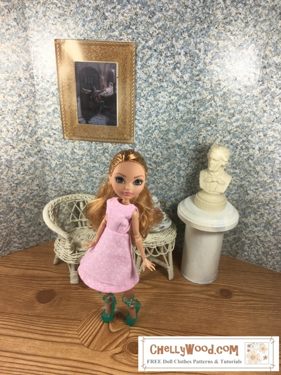 Image shows Ever After High doll wearing an handmade A-line dress and standing in a 1:6 scale diorama that shows the bust of a musician, a classical painting, and is decorated with a wicker table and chair. On the table is a 1:6 scale porcelain tea set for little dolls. The Ever After High (EAH) doll wears a dress that has been sewn by hand. Overlay offers the sewing tutorials and free doll clothes patterns website: ChellyWood.com and states that this website has free doll clothes patterns and tutorials for dolls of many shapes and sizes.