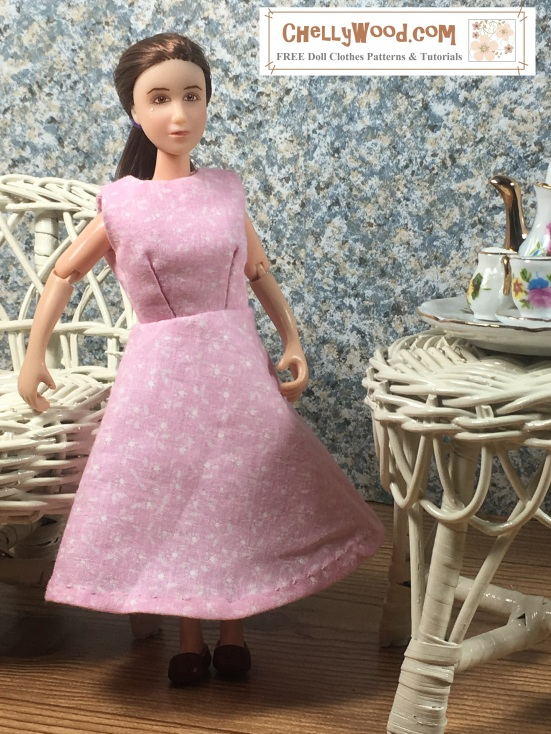 "Image shows 6"" Breyer Rider doll wearing an handmade A-line dress and standing in a 1:6 scale diorama that shows the bust of a musician, a classical painting, and is decorated with a wicker table and chair. On the table is a 1:6 scale porcelain tea set for little dolls. The 6"" Breyer Rider doll wears a dress that has been sewn by hand. Overlay offers the sewing tutorials and free doll clothes patterns website: ChellyWood.com and states that this website has free doll clothes patterns and tutorials for dolls of many shapes and sizes."