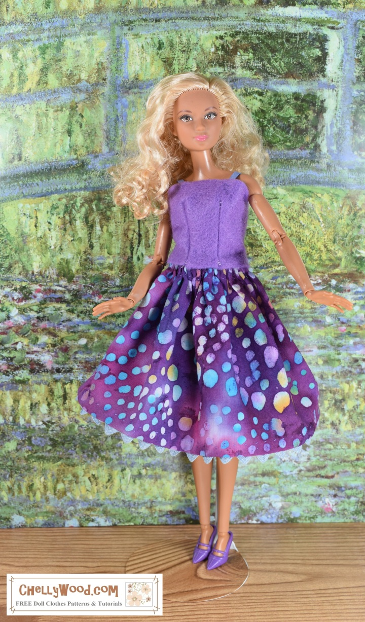 Please visit ChellyWood.com for FREE printable sewing patterns for dolls of many shapes and sizes. The image shows a Made-to-Move Barbie wearing a hand-made felt summer top with ribbon straps. She also wears a batik-patterned skirt with ric rac trim that creates a sort of scalloped look at the bottom of the skirt. She poses before an image of Monet's green bridge. Her little purple plastic shoes are high-heels with a pointed toe. Image offers the following watermark: ChellyWood.com: free printable sewing patterns and tutorials.