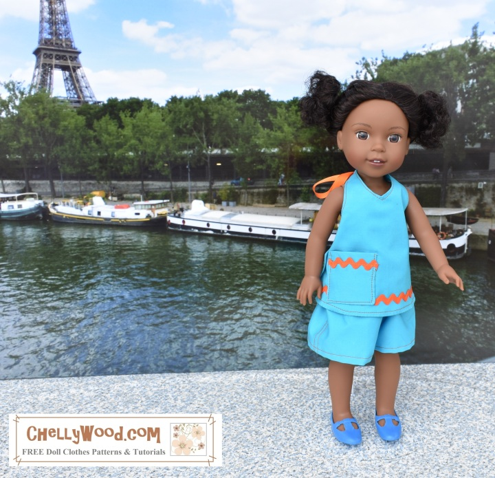 Visit ChellyWood.com for FREE printable sewing patterns for dolls of many shapes and sizes. Image shows the Wellie Wisher doll Kendall wearing a handmade summer outfit made up of a pocket-decorated halter style summer top combined with roomy shorts. She wears blue MaryJane shoes, and she seems to stand atop a concrete base with the Seine River and the Eiffel Tower in the background. Her turquoise blue summer clothes match her blue Mary Jane shoes, and the outfit is edged with bright orange ric rac. An orange satin ribbon ties the halter top in the back. The Wellie Wishers doll's expression is curious as she looks slightly right of the photographer. The overlay is a watermark on the photograph stating the URL where these free printable sewing patterns can be found: ChellyWood.com: FREE printable sewing patterns and tutorials for dolls of many shapes and sizes.