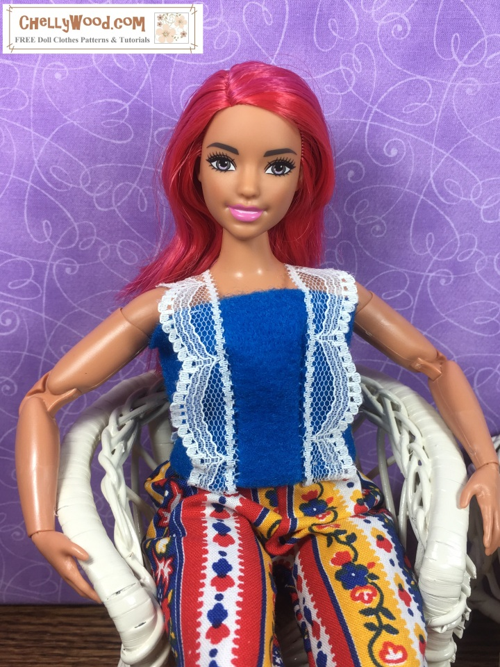 """Please visit ChellyWood.com for FREE printable sewing patterns and tutorials for dolls of many shapes and sizes. The image shows Curvy Made-to-Move Barbie wearing a Barbie-sized felt summer top with lace straps. The overlay says, """"ChellyWood.com: FREE printable sewing patterns and tutorials for dolls of many shapes and sizes."""" This is a preview image of the doll clothes patterns and tutorials that will be posted on ChellyWood.com this week. We will learn how to sew this easy-to-make DIY summer shirt (summer top) which fits a number of 11-inch, 11 and a half inch, and 12 inch fashion dolls including Barbie, made-to-move Barbie, Tammy dolls, Curvy Barbie dolls, and MTM Curvy Barbie dolls. The Barbie doll clothes summer shirt pattern is going to be free and printable like all of my other dolls' clothes patterns."""