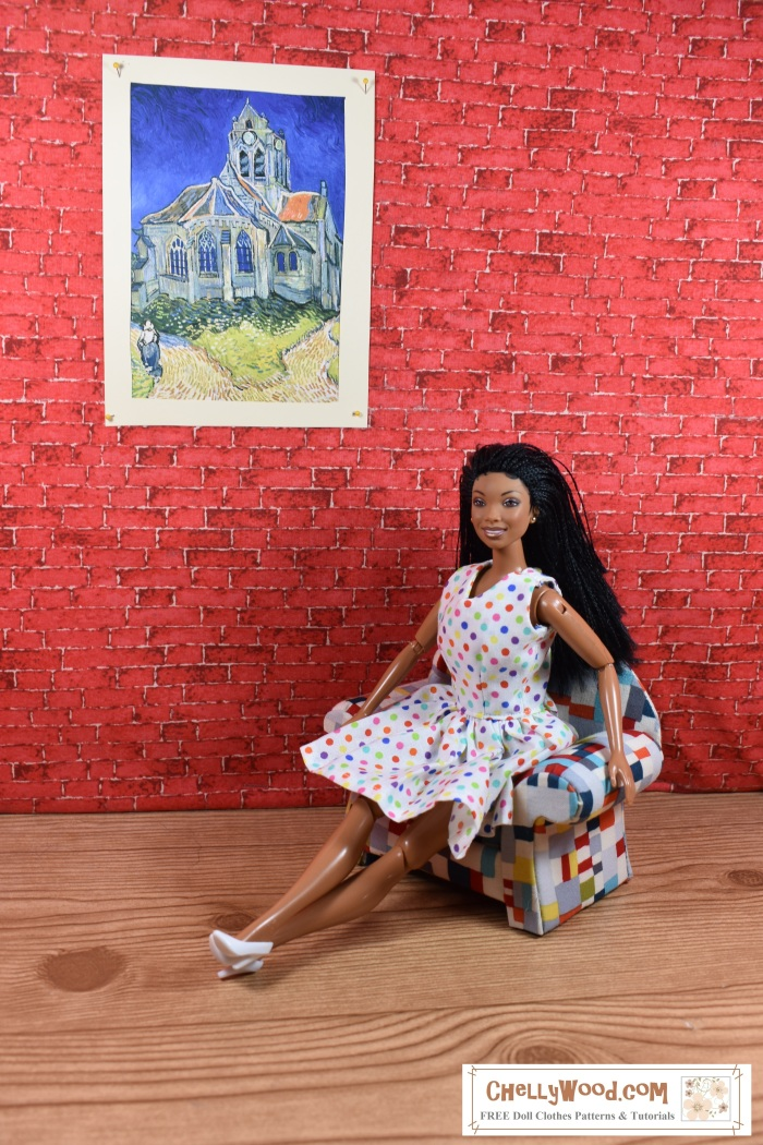Please visit ChellyWood.com for FREE printable sewing patterns to make doll clothes for dolls of many shapes and sizes. Image shows a Brandy Norwood doll wearing a hand-made polka-dot dress. She is seated gracefully on a multi-colored arm chair. Behind her, on the brick wall, is a 1:6 scale painting of a cathedral by Van Gogh. Her legs are stretched out before her, accentuating the swirls in her polka-dot dress's skirt. Her ankles and crossed, and she wears tiny white matching pumps. To make this dress for your Barbie-sized dolls, please visit ChellyWood.com, where you will find the free, printable sewing pattern and instructions in the form of a tutorial video (also free).