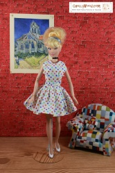 Follow this link for free printable patterns to make the dress shown on this doll: https://wp.me/p1LmCj-FKk