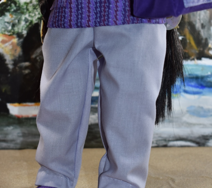 """The image shows the pants you can make for your 18 inch doll using ChellyWood.com's free printable sewing pattern for a simple elastic waist pair of doll pants. These pants will fit 18-Inch American Girl dolls, 46 cm Madame Alexander dolls, and many other 18"""" or 46 cm dolls of similar proportions. The image has a watermark that says """"ChellyWood.com: free printable sewing patterns for dolls of many shapes and sizes."""""""
