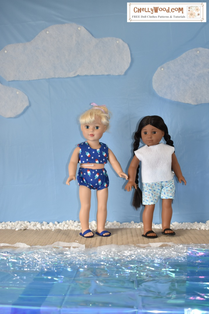 """The image shows an 18-inch American Girl doll (Kaya) and an 18 inch Madame Alexander doll playing on a beach. The beach is a home-made diorama including a table cloth-covered wall that looks like a blue sky with quilt-batting clouds overhead and vellum wrapping paper with tinsel on top to look like water on a fake-sand beach. The two dolls seem to be enjoying the sunshine as friends at the beach. The image has a watermark that says """"ChellyWood.com: free doll clothes patterns and more."""" The Madame Alexander doll wears a blue bikini that has been hand-sewn. Its fabric is dotted with little popsicles. The American Girl doll wears a hand-made felt shirt with nautical-print cotton shorts (also sewn by hand). Both girls wear DIY sandals to match."""