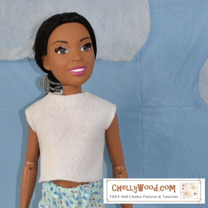 """The image shows a close-up of the 28-inch Barbie doll from Mattel (also called Just Play or Fashion Friend dolls). ChellyWood.com is the watermark on the image, and under ChellyWood.com, it says, """"free printable sewing patterns and tutorials."""" In fact, if you visit the website for Chelly Wood, you'll find dozens of free printable sewing patterns for dolls of many shapes and sizes, including this easy-sew felt shirt for 28-inch Barbie dolls and more."""