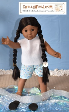 "This image shows a Kaya doll from American Girl doll company wearing handmade shorts and an easy-to-sew sleeveless shirt. She appears to be playing on a sandy beach, with splashing water around her feet. Her home-made flip-flops look like they're floating on the water. The watermark on this image says, ""ChellyWood.com: free printable patterns and tutorials."""