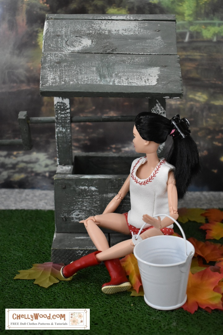 The image shows a Barbie doll looking inside a wishing well with a bucket beside her and fall leaves all around. She's wearing a summer outfit of a white tank top and polka dot red shorts along with irrigation boots. Her hair is done up in a pony tail. The website, ChellyWood.com, where this photo is found, offers free printable sewing patterns to fit Barbie and other dolls in the 11.5 inch fashion doll range. There are also many other dolls' clothes patterns found on the website, and all the doll clothes patterns are free and printable.