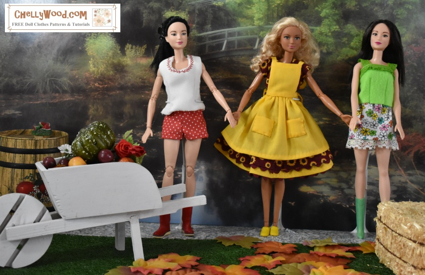 "The image shows Made to Move Barbies with a regular Barbie doll in a fall harvest / garden diorama scene. This diorama photo comes from ChellyWood.com, a website offering free printable sewing patterns for Barbie and many other dolls. This diorama scene has fall leaves, a wheelbarrow full of harvested vegetables from a garden, and a stack of hay bales with an apple cider barrel behind them. In the distance a garden has a river running through it with a bridge over the water. In front of all this, the three Barbies stand holding hands, facing the camera in hand-sewn doll clothes. Their outfits include (first Barbie doll) a white tank top edged in red stitching, a pair of red shorts with white polka dots, and a pair of irrigation boots; (second Barbie doll) a sunflower-printed dress with fluttery sleeves and a gathered skirt that is edged in burgundy rick-rack, having a pinafore of yellow that matches its petticoat of yellow; (the third Barbie doll) wears a handmade bright green felt shirt with green lace straps and green lace edging the top of the shirt along with a lace-edged floral mini-skirt and green go-go boots. The overlay offers the website, ""ChellyWood.com"" which is a website where you can find free printable sewing patterns and tutorials fo r making each of these Barbie doll outfits."