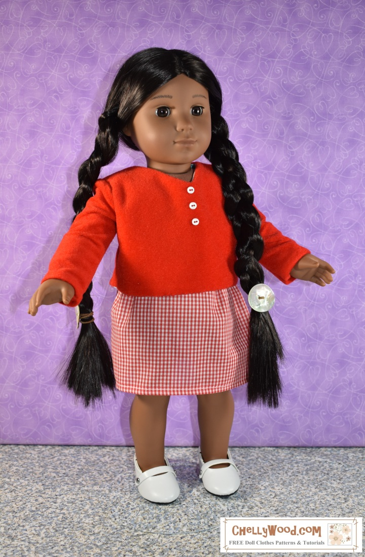 """The image shows an 18 inch American Girl doll (18 Kaya doll) wearing a handmade skirt of gingham print. She also wears a hand-sewn velvet top (shirt) with long sleeves and a v-neck collar. These 18 inch doll clothes are very easy to sew with free patterns from the website ChellyWood.com. Sewing patterns at ChellyWood.com focus on doll clothes and doll crafts for dolls of many shapes and sizes, including the 18"""" dolls like American Girl doll and Madame Alexander doll. The image shows the 18"""" doll modeling the free doll clothes patterns in a studio with a purple background. This easy-sew skirt uses an elastic waist, and ChellyWood.com not only offers the free patterns for making the whole outfit for 18"""" dolls, but it also offers free tutorial videos showing how to sew these simple garments. The image has a watermark that says """"ChellyWood.com: free printable patterns and tutorials."""""""