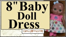 "The image shows an 8"" baby doll wearing a handmade doll dress designed with little holiday snowflakes. The overlay says, ""8-inch Baby doll Dress"" and offers the URL ChellyWood.com, where you can find the free patterns and easy-to-follow DIY tutorial videos showing how to sew this baby doll dress to fit 8-inch baby dolls like the one shown in the image (a bibi doll from the Lil cutesies collection made by JC toys)."