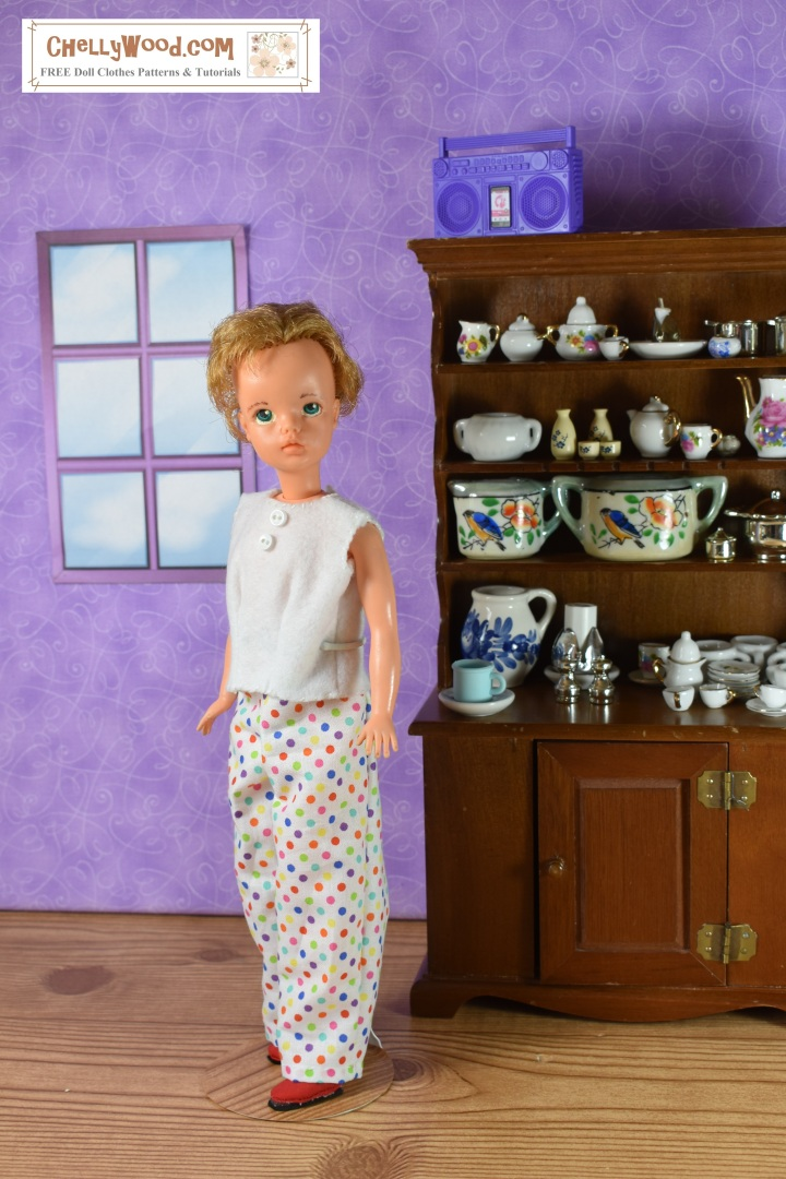 """The image shows a Tammy Doll (made by the Ideal Toy Corp) wearing handmade pajama pants and a handmade shirt. She stands in a 1:6 scale diorama with a doll-sized window behind her and a china hutch leaning up against the wall behind the doll. The overlay says, """"ChellyWood.com: free patterns and tutorials for doll clothes"""""""