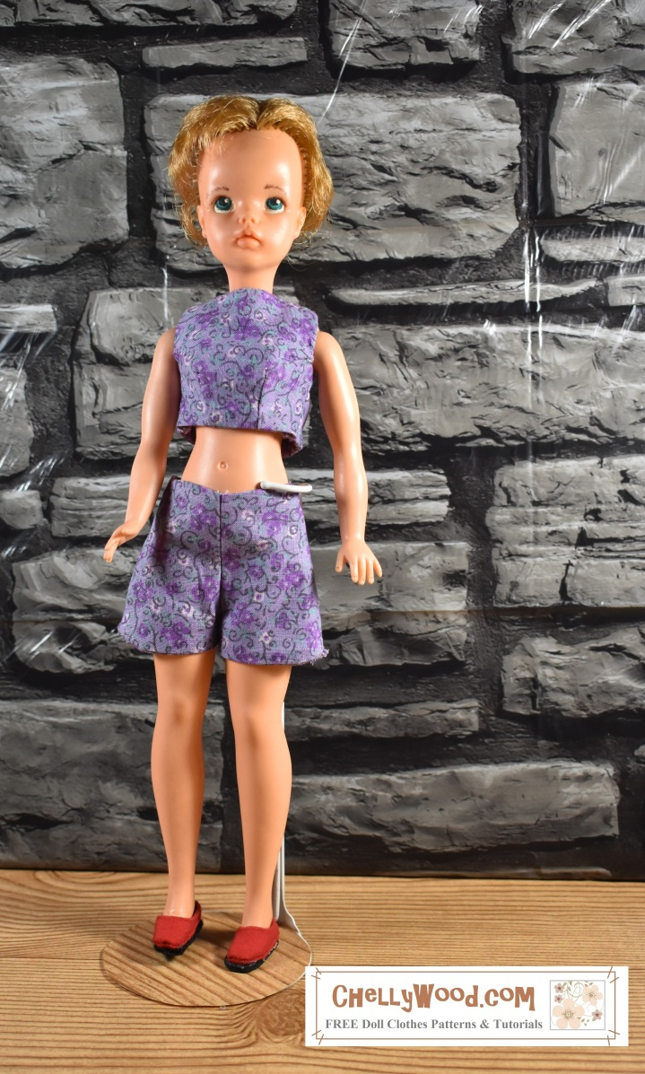 the image shows Ideal Toy Corp's Tammy doll wearing a pair of shorts that are slightly too big for her and a crop top that fits her just right. The blog post on ChellyWood.com offers measurements for Curvy Barbie and asks whether or not Tammy dolls and Curvy Barbie can wear the same clothes. The illustration shows that the two dolls are not exactly compatible.