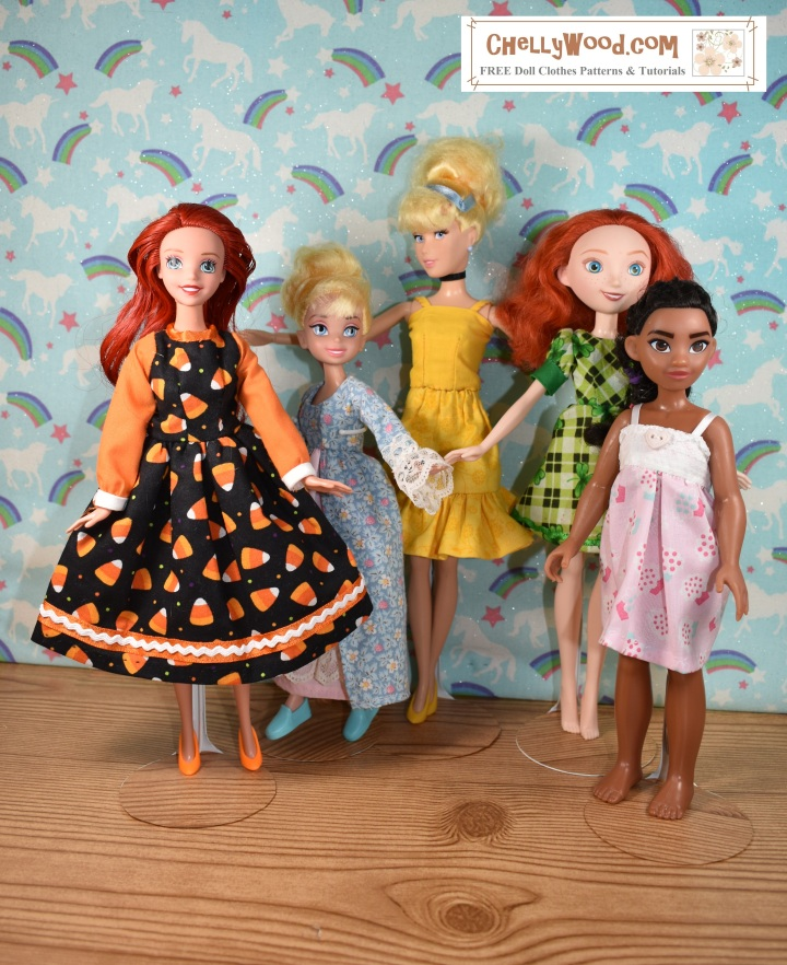 Please visit ChellyWood.com for FREE printable sewing patterns to fit dolls of many shapes and sizes. The image shows five different Disney Princess dolls modeling hand-sewn doll clothes (left to right): an Ariel doll wears a handmade candy corn Halloween dress; a Tinkerbell wears a Victorian ball gown; a Cinderella Barbie-sized doll wears a yellow tank top with an elastic-waist skirt; Disney's Merida doll wears a green puff-sleeve dress with cuffs in a St. Patrick's Day green plaid pattern; Moana models a strappy pajama baby doll nightgown. Each of these patterns is free and printable on ChellyWood.com where you can find hundreds of free printable sewing patterns for dolls of many shapes and sizes.