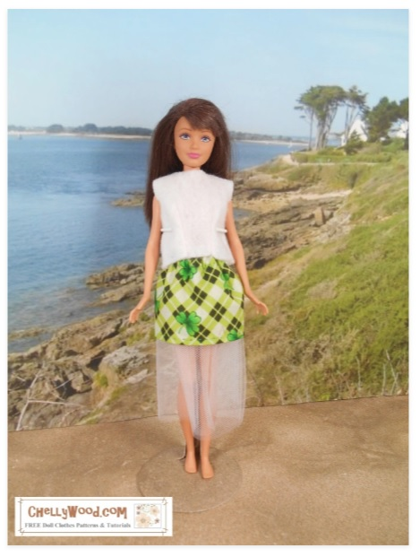 The image shows a Mattel Skipper doll wearing a handmade skirt with tulle. The fabric uses a shamrock plaid pattern for St. Patrick's day.
