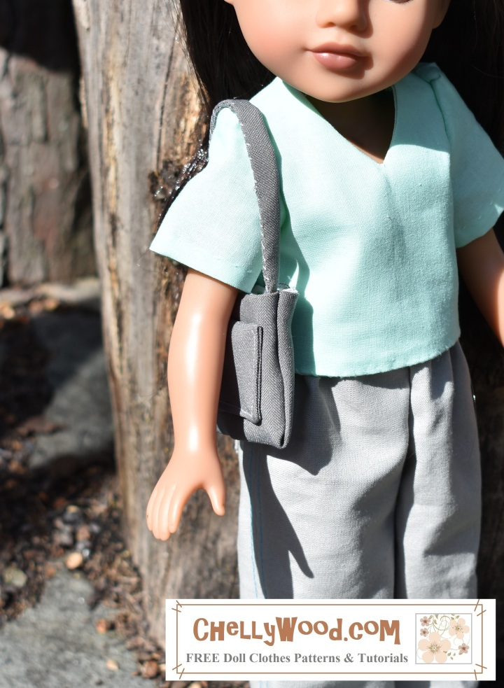 """The image shows a H4Hgirl doll with a strappy purse slung over her shoulder. the purse has a large pocket in one side. The overlay says, """"ChellyWood.com"""" and suggests that the website mentioned offers free printable sewing patterns for dolls of many shapes and sizes."""