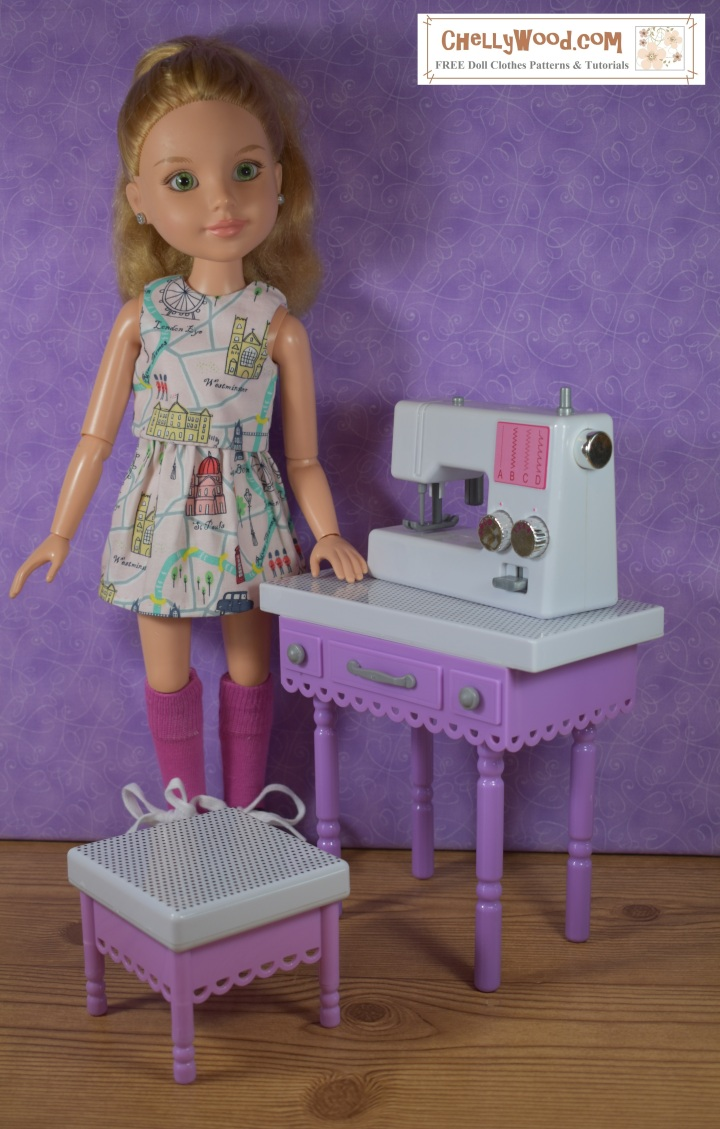 The image shows a BFC Ink doll modeling a skirt and sleeveless top that has been handmade of London-print fabric. She stands beside a miniature sewing machine and sewing table with stool. She wears knee-high socks. The URL provided in the watermark in the corner of the image is ChellyWood.com (a place where you can download free PDF doll clothes patterns).