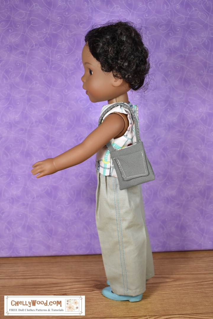 """The image shows a Wellie Wisher doll (Kendall from American Girl) wearing a handmade round-neck sleeveless reversible top and khaki pants. She is turned sideways so the top stitching, which runs from the waist of her pants to the hem, is visible. She holds a handmade purse with a pocket. At the bottom of the image, there's a URL for the website where you can print the free pattern for making this entire outfit: ChellyWood.com. The Chelly Wood website's motto is """"free doll clothes patterns and tutorials for dolls of many shapes and sizes."""" Patterns are offered as a PDF download and a MS Word document, for easy printing."""