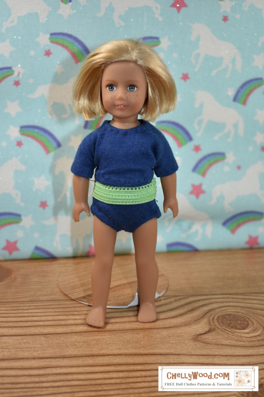 "The image shows a 6-inch American Girl doll modeling a pair of handmade briefs (underpants / knickers) with a handmade T-shirt (tee shirt). The watermark says ""ChellyWood.com"" which is the URL of the website where you can download free printable sewing patterns for doll clothes, including this pair of underpants and this shirt pattern for 6 inch dolls like American Girl."