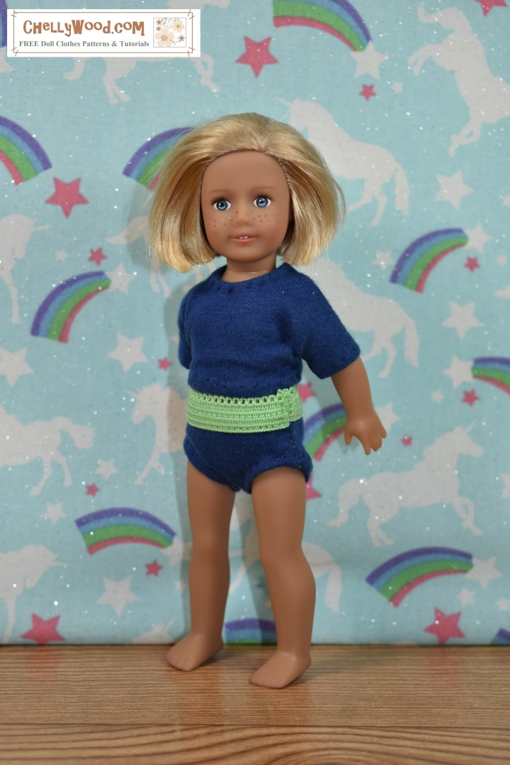 "The image shows a 6-inch American Girl doll modeling a pair of handmade briefs (underpants / knickers) with a handmade T-shirt (tee shirt). The watermark says ""ChellyWood.com"" which is the URL of the website where you can download free printable sewing patterns for doll clothes, including this pair of underpants and this shirt pattern for 6 inch dolls like American Girl. In this image, you can see the side seam where the underpants have been sewn together along the outseam."