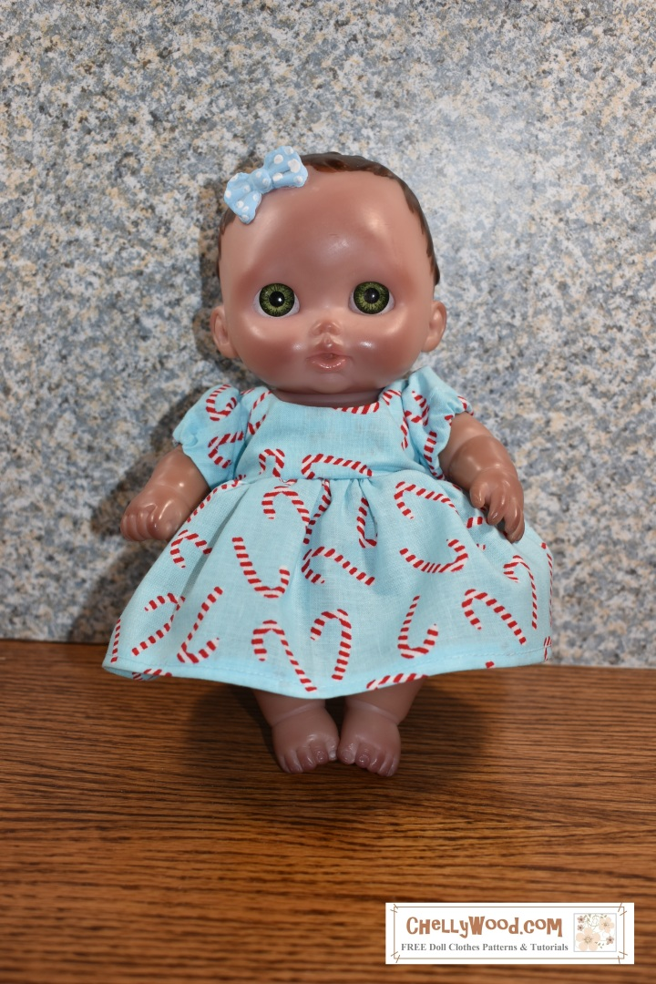 Under the image is a link to all the free patterns and tutorials needed to sew a short-sleeved dress for 8-inch baby dolls like the Lil Cutesies doll made by JC Toys.
