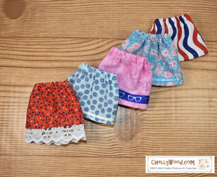 This image shows five different styles of skirts made to fit a 6-inch American Girl doll, using the free pdf pattern for 6 inch AG mini dolls found at ChellyWood.com.