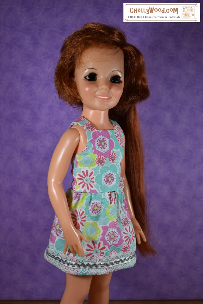 This image shows a close-up of the Ideal Toy Corporation vintage Crissy doll with extendable hair modeling a recently hand-sewn dress that's made of a 70's style of fabric.