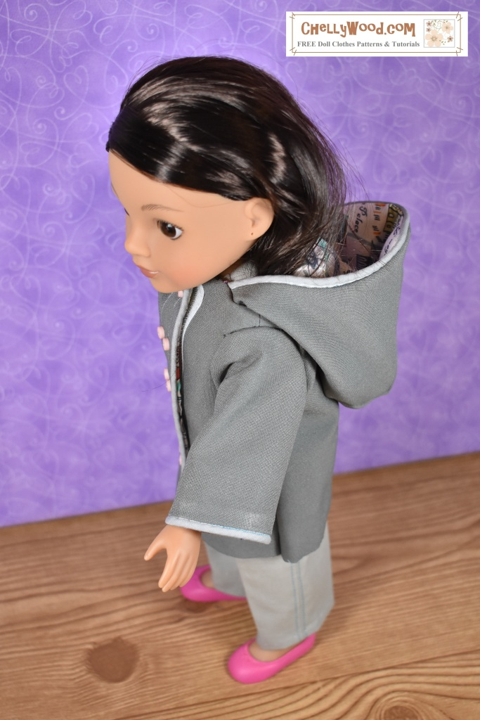 The image shows a Hearts-for-hearts girl doll wearing a handmade rain coat with a hood. The accompanying website offers measurements for the Hearts4Hearts Girls so anyone wanting to sew this raincoat (using Chelly Wood's free coat patterns) can easily take measurements of their own 14-inch or 15-inch or 16-inch doll to see if the free coat pattern will fit or not.