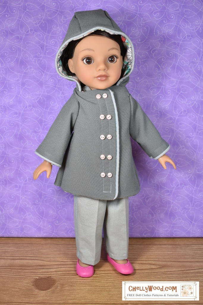 "This image shows a Hearts for Hearts (H4H or Hearts4Hearts) girl (doll) wearing a hand-made raincoat with a hood. The raincoat uses piping along the front placket, the opening for the hood, and the sleeves. The front placket offers a double-breasted looks, although it's actually sealed with Velcro. The topstitching on the front placket has pairs of tiny pink buttons running down the front of the coat. Inside the hood, we see a peek of pink cotton fabric with a London-themed print, which was used to line the coat with cotton lining. This hooded rain coat is made of Polyester, which gives it a plastic-like sheen and the doll's eyes shine brightly out from under the hood of her coat. The watermark says, ""ChellyWood.com"" and suggests that the website has free printable patterns and tutorials."