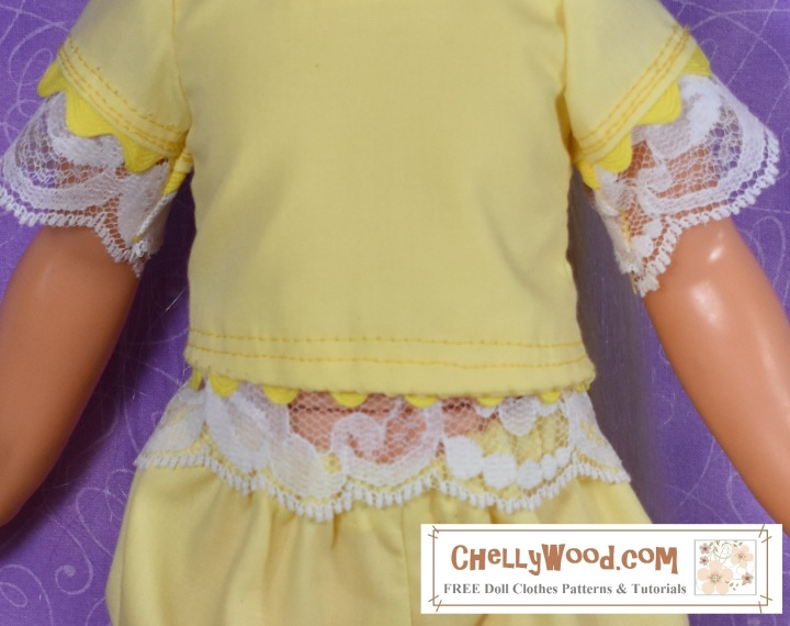 The image shows a lace-trimmed yellow top that seems to fit a Crissy doll, but with a slight gap at her middle.