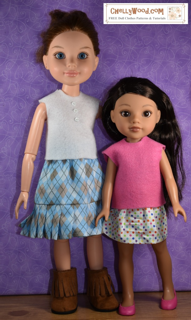 The image shows a BFC Ink doll standing next to a Hearts for Hearts Girl (Consuelo). They both wear felt shirts with no sleeves. The BFC Ink doll's clothes can be described like this: white felt sleeveless top with blue plaid skirt that has knife pleats. The skirt is knee-length on the BFC Ink doll. The Hearts4Hearts doll's clothes can be described thus: pink sleeveless top with knee-length polka dot skirt. The image is part of a hashtag tape measure Tuesday measurements comparison on ChellyWood.com, which is meant to help doll clothes sewists / seamstresses with doll measurements for sewing projects. The image should be compared to another similar image toward the bottom of the blog post, in which the two dolls stand side by side again, but wearing each other's clothing in a clothes swap.
