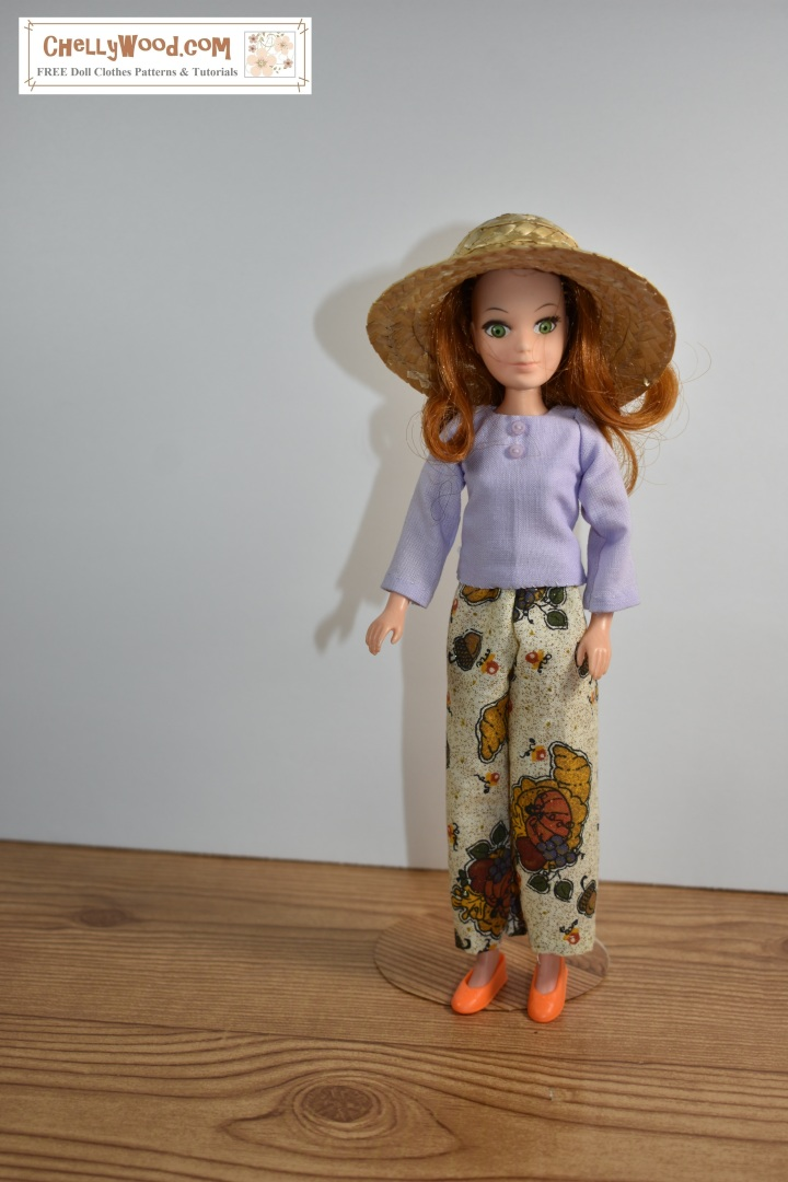 The image shows a World of Love Flower doll modeling a pair of harvest-themed pants. You can sew a pair of pants like these using the free patterns on ChellyWood.com