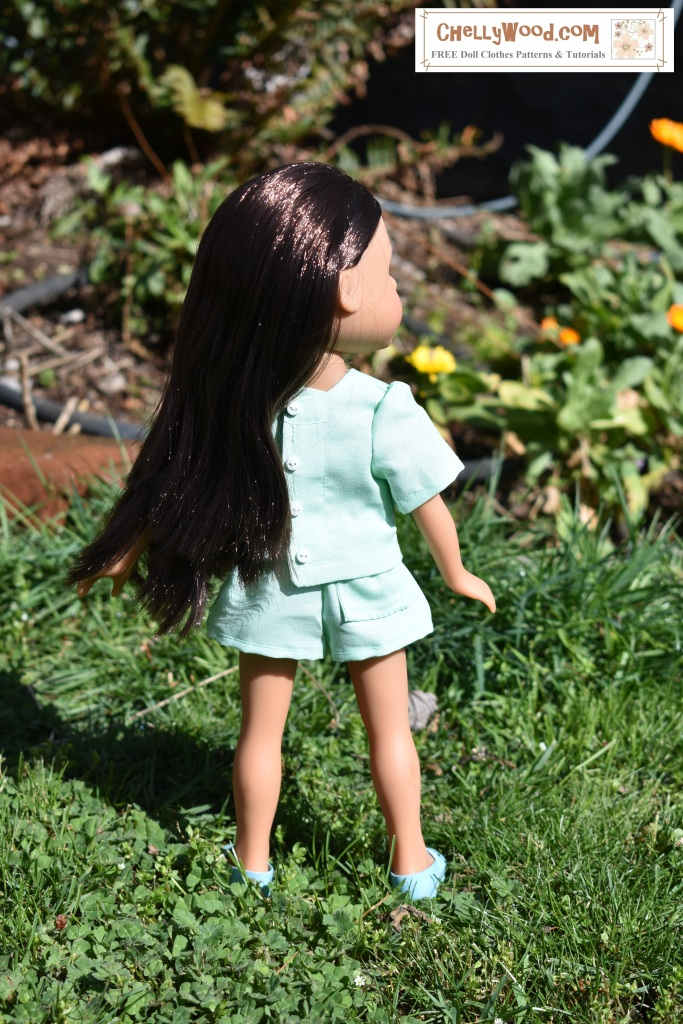 "Please visit ChellyWood.com for free printable sewing patterns for dolls of many shapes and sizes. The image shows a Hearts for Hearts Girl (H4H or Hearts4Hearts or Hearts 4 Hearts dolls) standing in a garden of grass and flowers. She wears mint green shorts with a shirt that buttons up the back. The shorts have a single back pocket. There's a FREE printable PDF pattern for sewing this outfit on the website that's watermarked on the photo, ChellyWood.com (free printable sewing patterns for dolls of many shapes and sizes). This doll clothes pattern will also fit dolls in the 13-inch (33 cm), 14 inch (35.5 cm), 15 inch (38 cm), 16 inch (40.5 cm), and even some 17 inch or 18 inch (43 cm to 46 cm) size range. All patterns on ChellyWood.com are free and printable using the ""Creative Commons Attribution"" symbol."