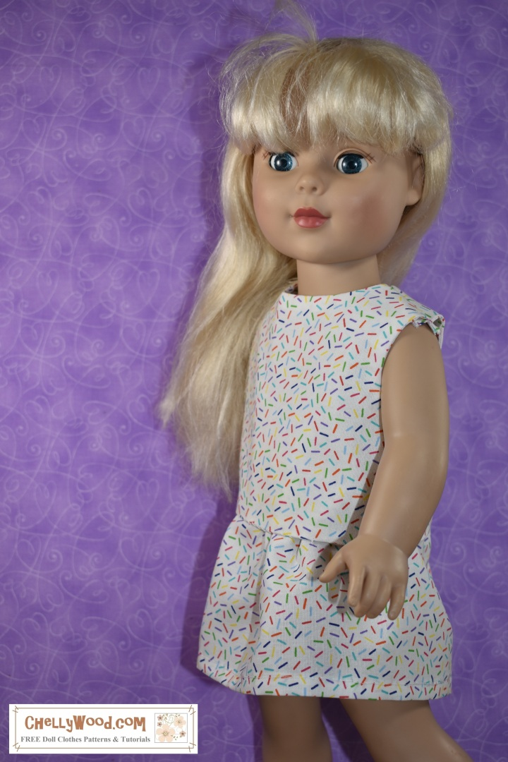 """In this image, we see an 18 inch doll modeling a sleeveless shirt with an elastic-waist skirt. The fabric is made of a confetti-patterned cotton. The patterns are free and printable for sewing these doll clothes for your 18 inch dolls, using the """"Creative Commons Attribution"""" mark, and you can download the free PDF patterns for these doll clothes at ChellyWood.com (but by downloading these free PDFs you agree to share images of these patterns with your friends, family, and followers, so they too will know where to find free printable sewing PDF patterns for 18"""" doll clothes online)."""