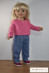 The image shows an 18-inch doll wearing a pair of jeans / pants and a long-sleeved shirt. The watermark on the image tells you where you can download the free printable sewing patterns (PDF download) for sewing this outfit: ChellyWood.com and this website offers hundreds of free printable sewing patterns for dolls of many shapes and all different sizes.