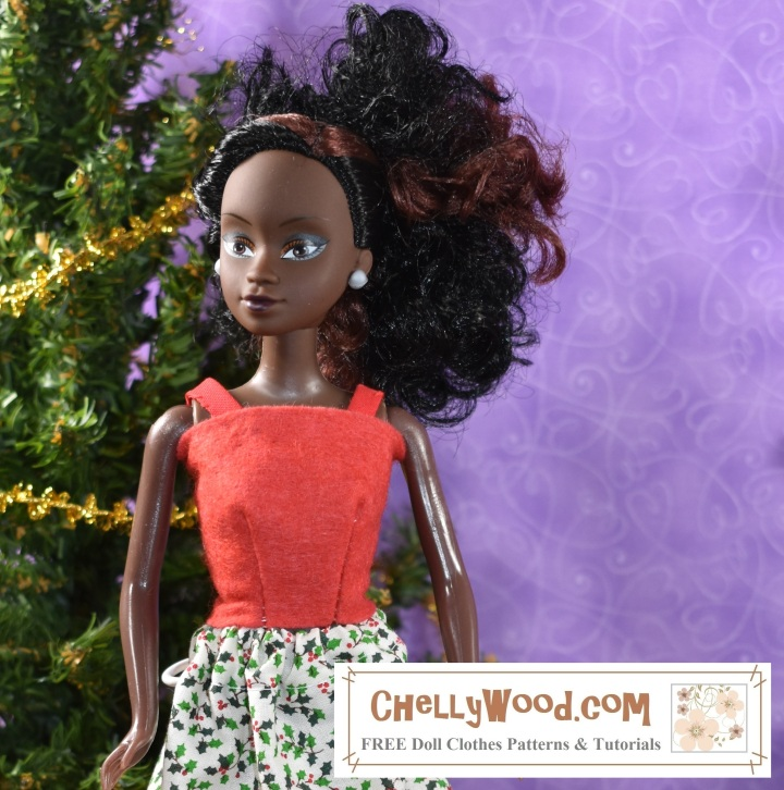 The image shows Azeezah, a doll from the Queens of Africa series. She models a felt tank top which was designed by Chelly Wood of ChellyWood.com. Visit ChellyWood.com to download the free printable sewing pattern to make this summer strappy top using ChellyWood's free patterns and tutorial videos.