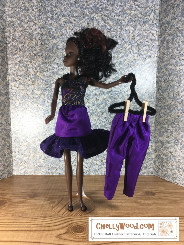 Please visit ChellyWood.com for FREE printable sewing patterns to fit dolls of many shapes and all different sizes. The image shows a Queens of Africa Azeezah doll wearing handmade clothes: a skirt with glittery ruffle and a strappy summertime top. She holds up a pair of ankle pants on a hanger. The overlay tells you where you can find free PDF sewing patterns for making this entire outfit, plus tutorial videos showing and telling how to make each item of doll clothing: ChellyWood.com