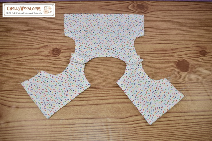 "This image shows an unfinished bodice sewing project for 18 inch doll clothes. The bodice has both front pieces sewn to the back piece across the shoulder seam. The blog post that accompanies this image on ChellyWood.com answers the question, ""What is a seam allowance used for?"""