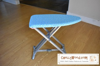 Please click on the hyperlink in the caption for the tutorial video that teaches you how to make a child's ironing board cover. The photograph shows a child's ironing board with a handmade fabric cover held on by elastic.